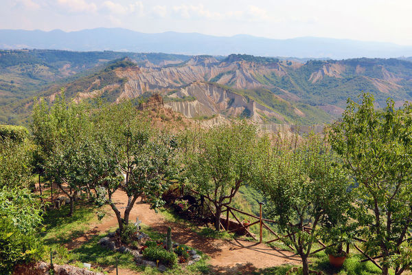 Italian countryside and trees seen from the hilltop village of Civita di Bagnoregio, Lazio, Italy