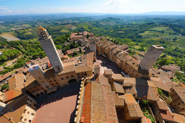 View from the Torre Grossa over the rooftops of San Gimignano and the Tuscan countryside, Tuscany, Ital