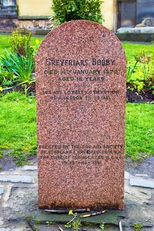Grave of Greyfriars Bobby the loyal Skye Terrier that stayed by his master's gave
