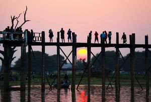People crossing the U Bein Bridge at sunset, Amarapura, Myanmar