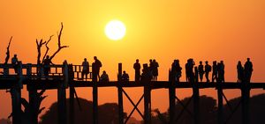 Silhouettes on the U Bein Bridge at sunset, Amarapura, Myanmar