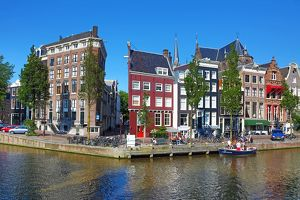 Singel Canal with Traditional Dutch houses in Amsterdam, Holland