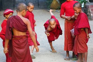 Young Buddhist monks playing at a temple in Amarapura, Mandalay, Myanmar (Burma)