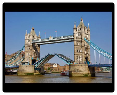 Tower Bridge raised on the River Thames, London