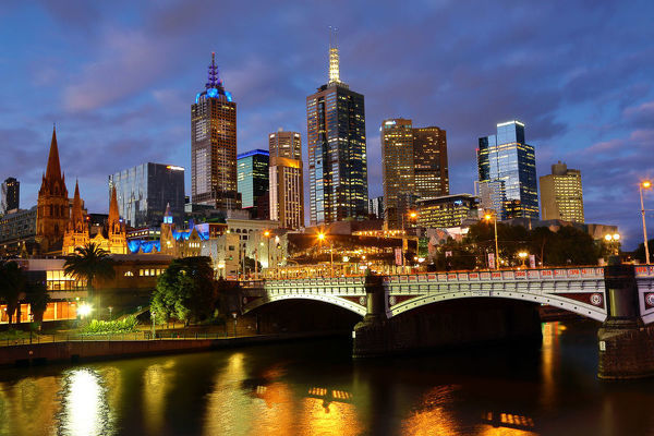 City skyline of Melbourne at sunset and Princes Bridge over the Yarra River, Melbourne, Victoria, Australia