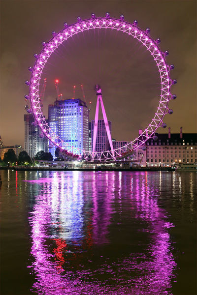 The London Eye illuminated pink in support of the Walk the Walk Moonwalk, an overnight charity walking marathon in aid of the breast cancer charity in London