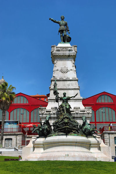 The Mercado Ferreira Borges or Old Market with the statue of Henry the Navigator in the Praca do Infante Dom Henrique in Porto, Portugal