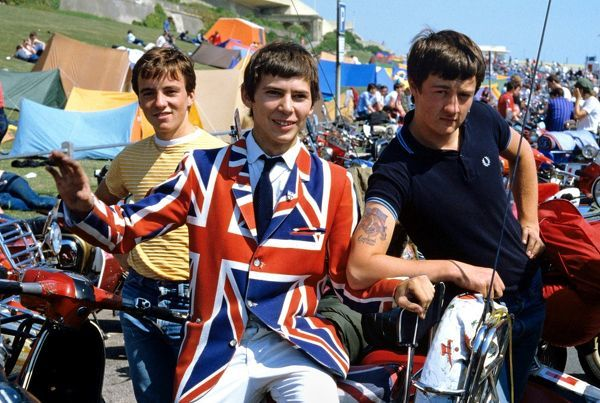Mods in Brighton in 1982, wearing a Union Jack jacket sitting on scooters
