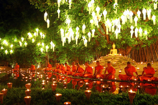 Monks celebrate the Loy Krathong festival at Wat Phan Tao Temple, Chiang Mai, Thailand with candles and sky lanterns in a sombre and moving ceremony which reflects the mourning for King Bhumibol. All the Loy Krathong festivities were reduced in Chiang Mai
