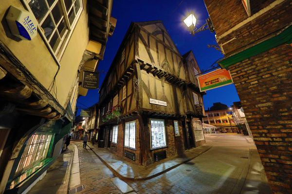 Shambles and Little Shambles street scene with Tudor style buildings at night in York, Yorkshire, England
