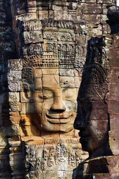 Stone face in the ruins of the Bayon Khmer Temple, Angkor Thom, Siem Reap, Cambodia