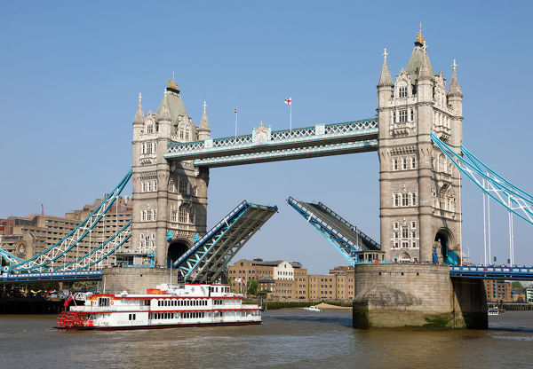 Tower Bridge raised for Dixie Queen Paddlesteamer on the River Thames in London