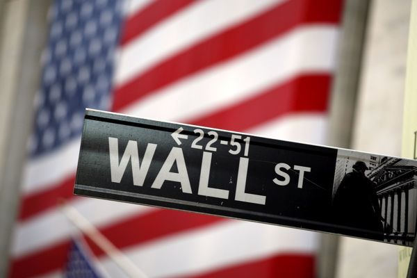 Wall Street sign and American Flag in New York, USA