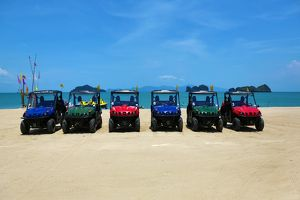 4X4 jeeps on a tropical sandy beach, Langkawi, Malaysia