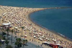 Aerial view of crowds on the crowded beach, Barcelona, Spain