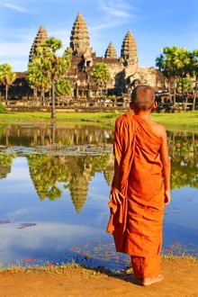 Angkor Wat Temple with young Buddhist Monk, Siem Reap, Cambodia