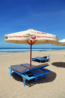 Beach umbrellas and deckchairs on Legian Beach, Denpasar,Bali, Indonesia