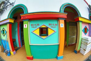 Brightly coloured toilet with colourful decoration in Little India in Singapore