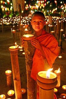 Buddhist Monk with candles, Loy Krathong, Chiang Mai, Thailand