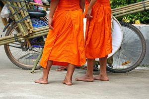 Buddhist Monks buying brushes, Vientiane, Laos