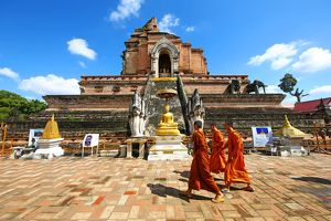 Buddhist Monks at Chedi at Wat Chedi Luang Temple in Chiang Mai, Thailand