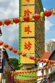 Chinese lanterns hanging in the street between buildings in Chinatown, Singapore