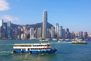 The city skyline of the Central area of Hong Kong and ferries in Victoria Harbour in Hong Kong