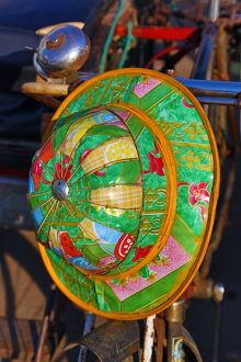 Colourful hat hanging on a bicycle, Yangon, Myanmar