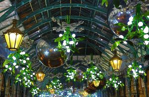 Covent Garden Christmas decorations and lights shaped like mistletoe in London