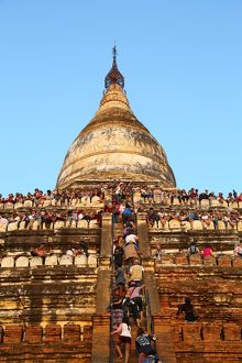 Crowds of tourists on Shwesandaw Pagoda to watch the sunset in Bagan, Myanmar (Burma)