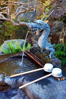 Dragon purifying water fountain at the Chingodo Shrine in Asakusa in Tokyo, Japan