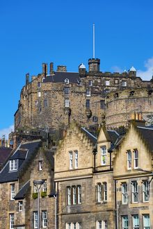 Edinburgh Castle and roofs of houses in Grassmarket in Edinburgh, Scotland, United