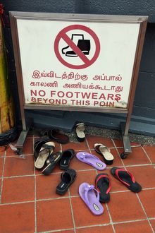 No footwear sign and shoes outside a temple in Singapore, Republic of Singapore
