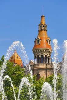 Fountain in the Placa de Catalunya and turret roofs of buildings in the Passeig de