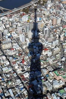 General aerial view of the city skyline with the shadow of the Tokyo Skytree tower