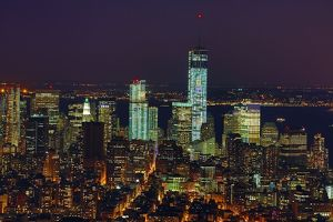 General aerial view of the New York Manhattan city skyline at night and One World Trade Center