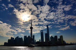 General view of the Pudong city skyline in Shanghai in silhouette with the Oriental Pearl TV Tower