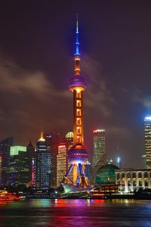 General view of the Pudong city skyline in Shanghai at night with the Oriental Pearl TV Tower