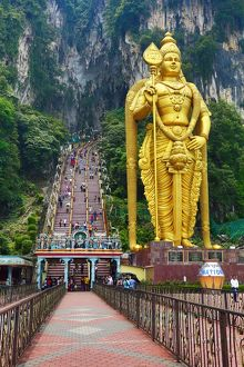 Giant golden statue of the god Murugan at the entrance of the Batu Caves, a Hindu