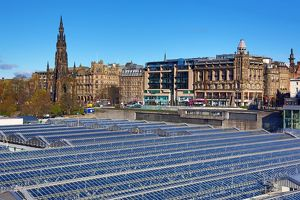 Glass panels on the roof of Waverley Station and the Scott Monument in Edinburgh