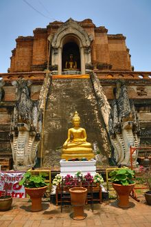 Gold Buddha statue and the Chedi at the Wat Chedi Luang Temple in Chiang Mai, Thailand