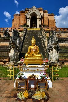 Gold Buddha statue at Wat Chedi Luang Temple in Chiang Mai, Thailand