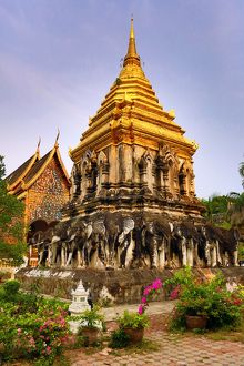 Gold chedi decorated with elephants in Wat Chiang Man Temple in Chiang Mai, Thailand