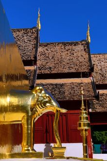 Gold elephant statue on the chedi at Wat Phra Singh Temple in Chiang Mai, Thailand