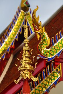 Gold naga roof decorations at Wat Panping Temple in Chiang Mai, Thailand