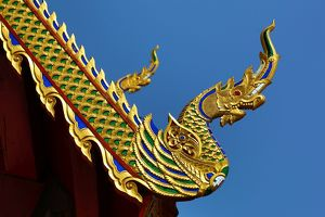 Gold roof decorations at Wat Sum Pow Temple in Chiang Mai, Thailand