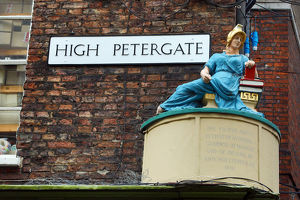 High Petergate street sign and statue in York, Yorkshire, England