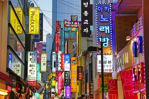 Illuminated shop signs of the shopping streets in Myeongdong in Seoul, Korea