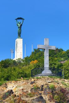 The Liberty Statue and Cross Monument on Gellert Hill in Budapest, Hungary