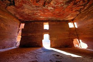 Light streaming through the windows of the Urn Tomb of the Royal Tombs in the rock